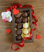 chocolate candies (truffles) of white and dark chocolate for a gift for Valentine's Day