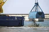 stock photo of dredge  - Dredging in a Industrial Harbor near Casablanca in Morocco - JPG