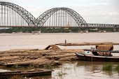 Port Activities On Ayeyarwady River,inwa Bridge In Background,Myanmar.