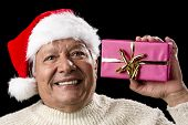 Excited Old Man With Santa Cap And Magenta Gift