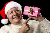 Aged, But Vivid Gentleman Pointing At Wrapped Gift