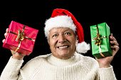 Poignant Aged Man Showing Red And Green Xmas Gifts