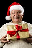 Grey-haired Man Offering Golden Wrapped Present