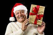 Smiling Old Man With Golden Gift Isolated On Black