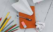 School, education. Book with pencils on the table