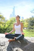 Woman doing yoga exercises in Central Park, NYC