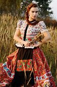 Young peasant woman, dressed in Hungarian national costume