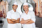 Portrait of confident male butchers smiling in butchery