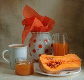 Still-life with a pumpkin and pumpkin juice