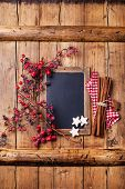 Vintage Christmas Background With Chalk Board, Branch With Red Berries, Xmas Cookies And Cinnamon St