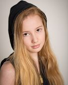 Teen Girl With Long Blond Hair and a Hood