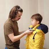 Father Dressing His Son