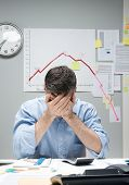 Desperate Businessman With Negative Business Chart