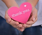 stock photo of give thanks  - Children holding or showing card with thank you text - JPG