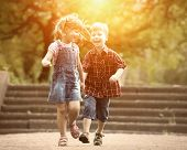 Happiness boy and girl fun outdoor under sunlight