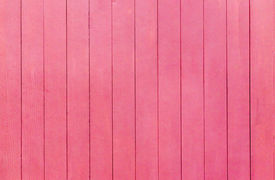 foto of red siding  - Old scratched and dirty wood painted red