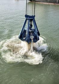 stock photo of dredge  - Dredging in a Industrial Harbor near Casablanca in Morocco - JPG