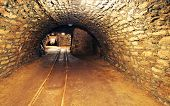 pic of gold mine  - Mine gold underground tunnel with a  railroad - JPG