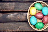 picture of easter basket  - Easter eggs lying in a basket - JPG