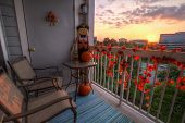 picture of scarecrow  - Sunset in autumn as seen from a porch decorated in fall decorations - JPG