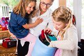 pic of handicrafts  - Family buying supplies  in handicraft store - JPG