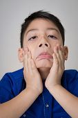 stock photo of sad boy  - portrait of asian cute boy sad and looking very disappointedon gray background - JPG