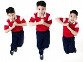 picture of pre-teen boy  - Group of Asian boy jumping over white background - JPG