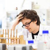 pic of scientific research  - Male researcher carrying out scientific research in a lab  - JPG