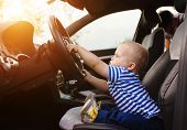 picture of steers  - Little boy playing with a steering wheel in a car - JPG
