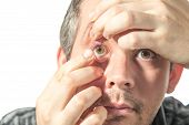 picture of contact lenses  - Picture of a man putting on a contact lens - JPG