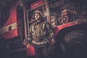 image of firefighter  - Firefighter near truck with equipment  - JPG