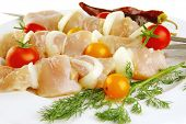 stock photo of kebab  - raw fresh chicken shish kebab on white plate - JPG