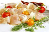 stock photo of kebab  - raw fresh chicken shish kebab on white plate - JPG