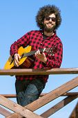 picture of afro hair  - Guitarist with plaid shirt and afro hair - JPG