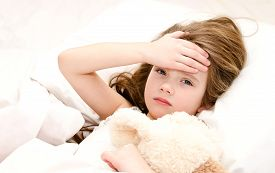 stock photo of toy dog  - Sick little girl lying in the bed with her toy - JPG