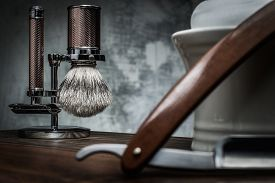 pic of razor  - Shaving razors and bowl with foam on wooden background  - JPG