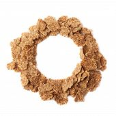stock photo of composition  - Round copyspace empty frame composition made of whole grain cereal flakes - JPG