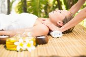 image of day care center  - Close up of an attractive young woman receiving facial massage at spa center - JPG
