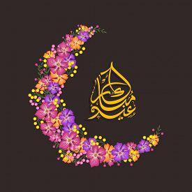 stock photo of ramazan mubarak  - Beautiful moon made by colorful flowers with Arabic Islamic calligraphy of text Eid Mubarak for Muslim community festival celebration - JPG