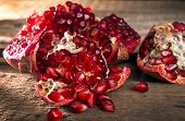 Pomegranat Grains. Pomegranate Close Up On Wooden Table poster