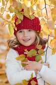Cute girl in autumn park portrait