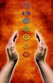 open female hands holding between them chakras symbols