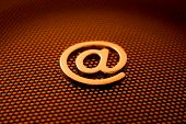 gold e-mail symbol & technology background See all metal letters in my portfolio