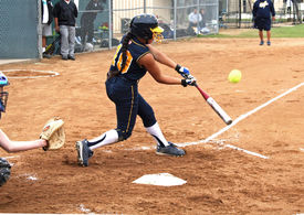 foto of fastpitch  - Fastpitch softball girl having made contact with softball flying off the bat - JPG
