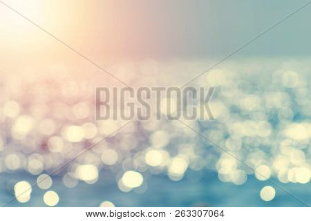 poster of Blur Tropical Beach With Bokeh Sun Light Wave Abstract Background. Copy Space Of Outdoor Summer Vaca