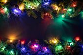 Christmas holiday background with copy space for text. New Year concept. Glowing fairy lights and de poster