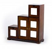 stylish wooden cabinet over white background