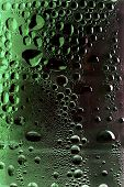 condensation on green drinks bottle