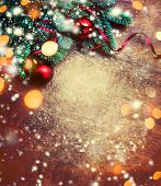 Christmas Background With Festive Decoration, Pine Tree Branch, Snowflakes And Bokeh Lights On  Dark poster