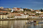 Porto, Portugal, is a fascinating and vibrant city on the Douro river one of most respected tourist  poster